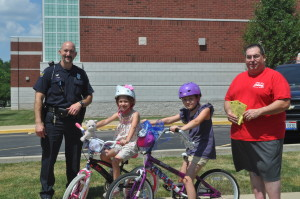 Officer Justin Brewer, Tony G's Pizza and Bakery owner Tony Glashauckas, and students from Gilles-Sweet School